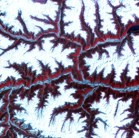 April 12th, 2001: Description: Soaring, snow-capped peaks and ridges of the eastern Himalaya Mountains create an irregular white-on-red patchwork between major rivers in southwestern China. The Himalayas are made up of three parallel mountain ranges that together extend more than 2,900 kilometers. Source: ASTER To learn more about the Landsat satellite go to: http://landsat.gsfc.nasa.gov/